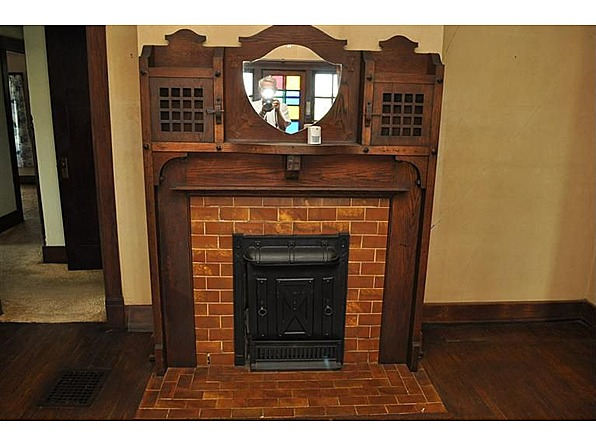 Arts and crafts craftsman woodwork fireplace in this house for Craftsman fireplaces photos