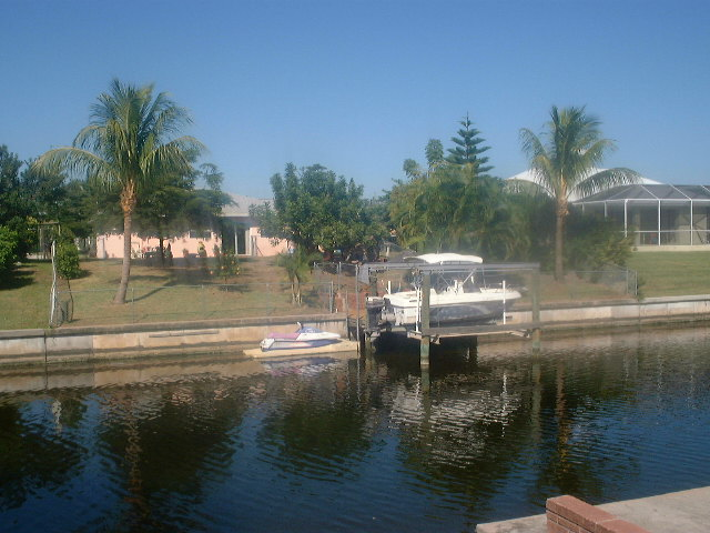 Photos of cape coral florida florida sun group auto for Canal home designs