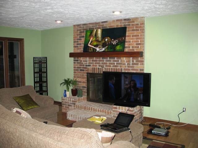 Want to mount TV above fireplace but can I? (countertop, paint ...