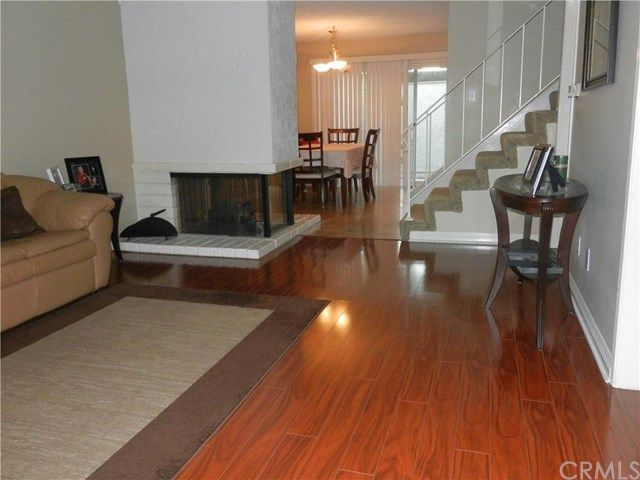 Direction Of Tile In Kitchen Perpendicular To Direction Of Laminate Wood In Living Room