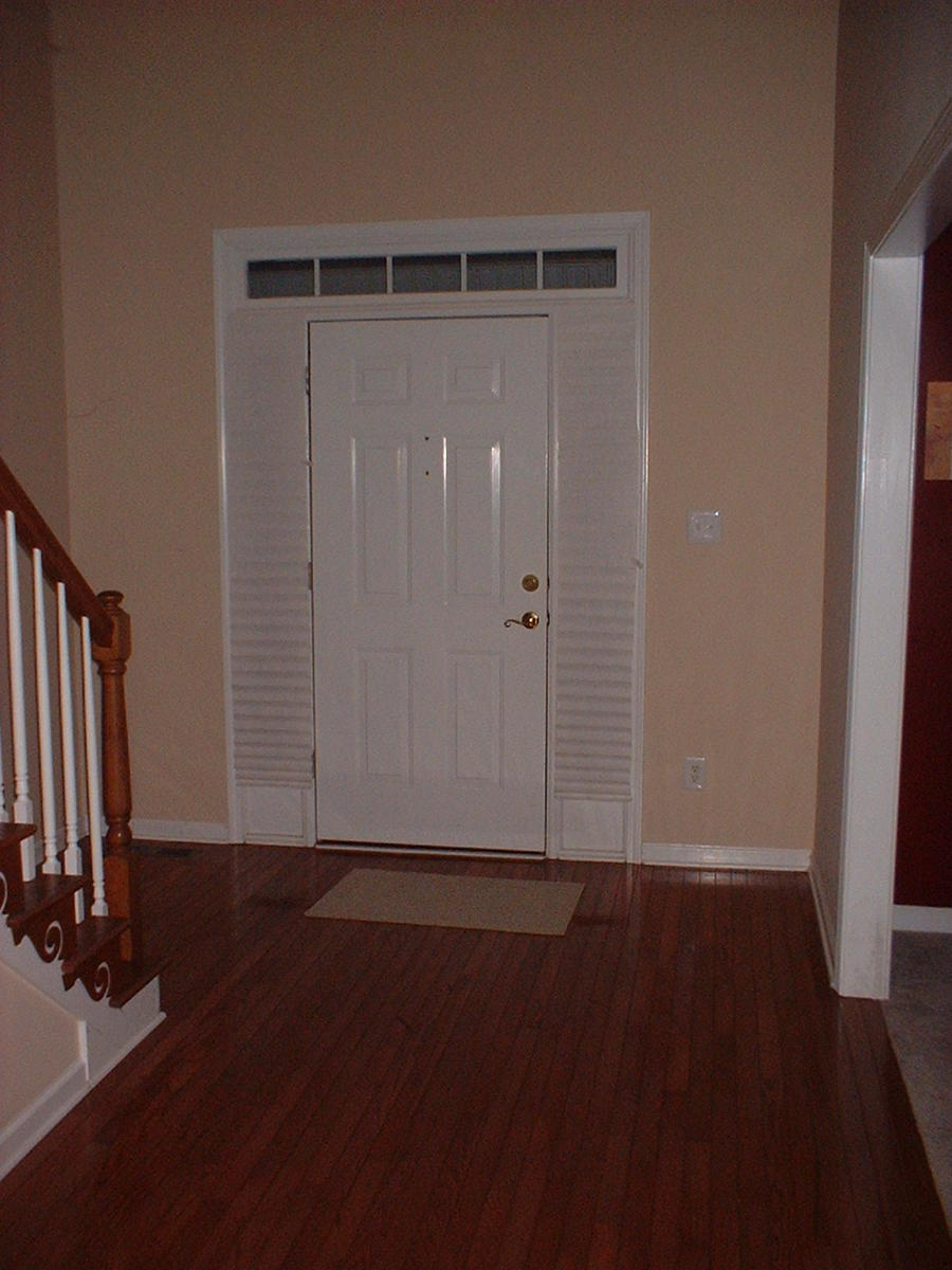 Best decorating ideas for 2 story foyer staircase color for Foyer makeover ideas