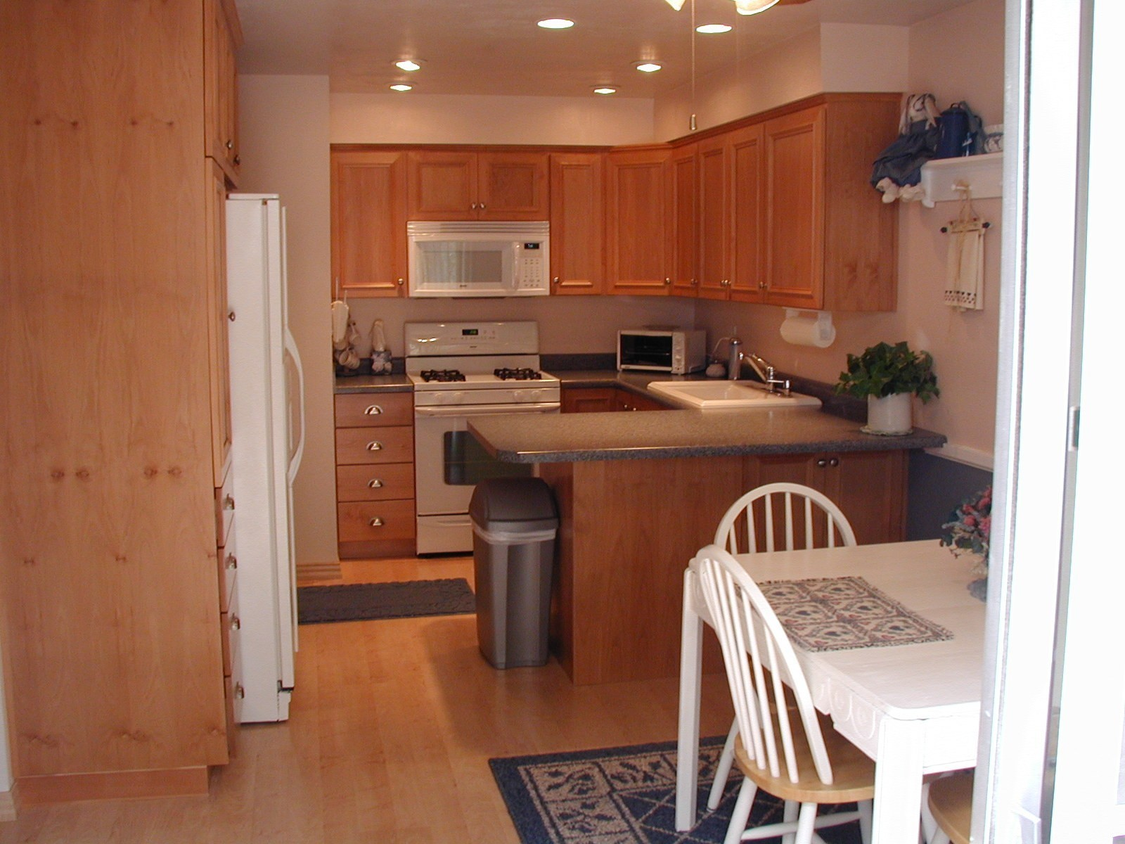 Kitchens Without Islands lighting in kitchen with no island? (floor, paneling, countertops