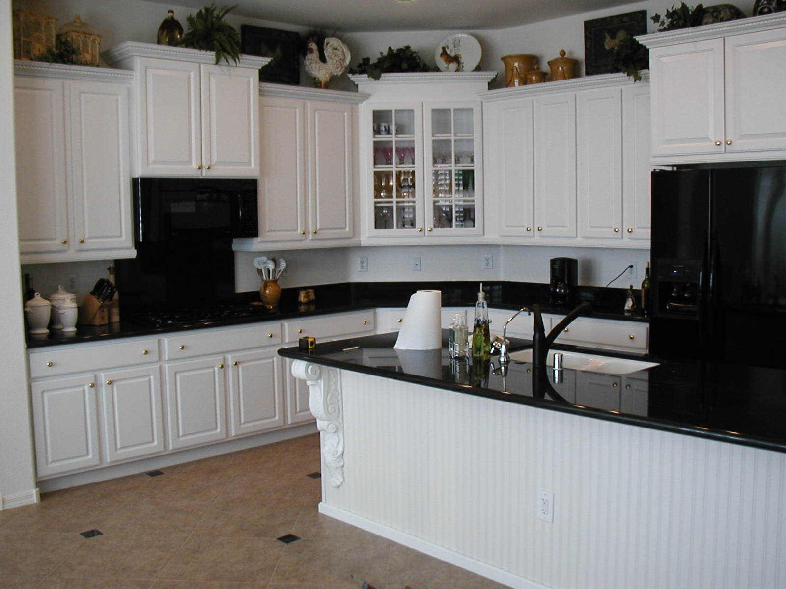 Black kitchen cabinets white appliances kitchen cabinets for Kitchen designs black