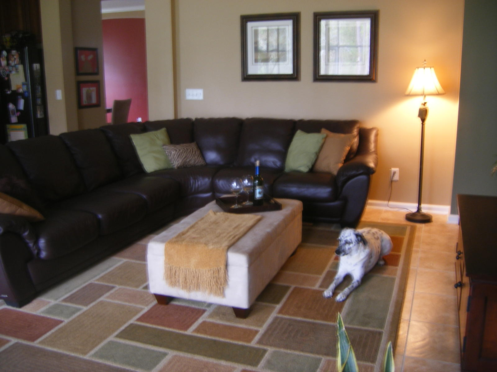 Decorating with leather sofa (mirror, hardwood floors, fireplace  title=