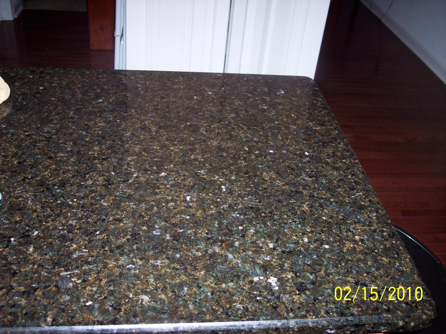 Granite countertop pictures white cabinets remarkable home for Granite colors for white cabinets