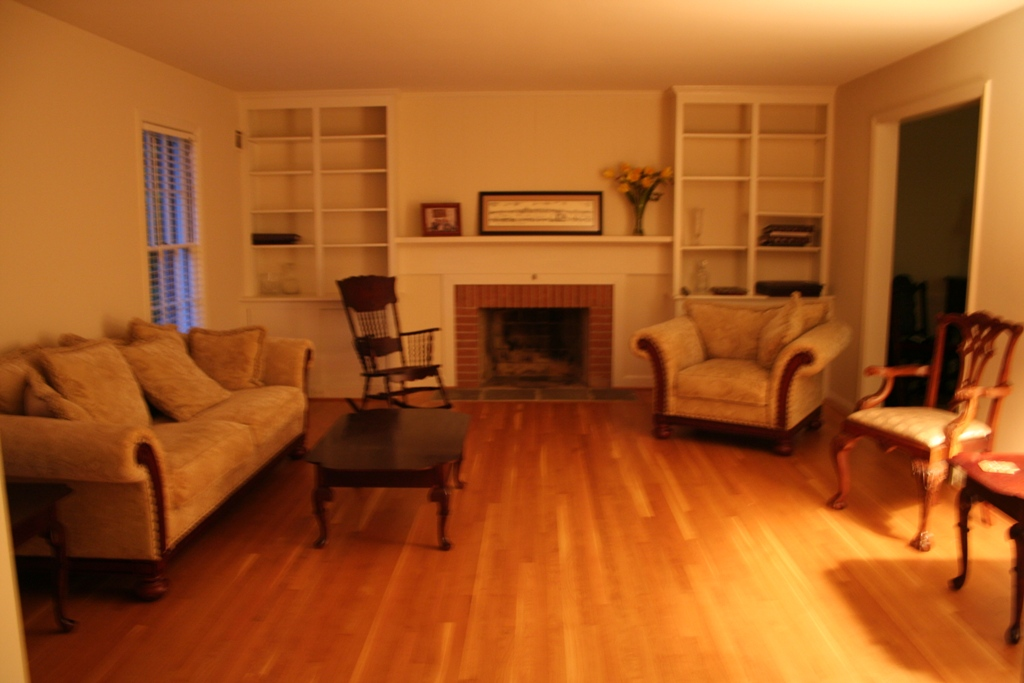 Help decorating an oddly shaped room fireplace color - How to decorate odd shaped living room ...