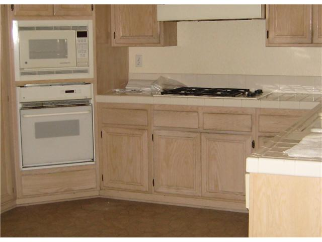 Stain my kitchen cabinets darker for Staining kitchen cabinets
