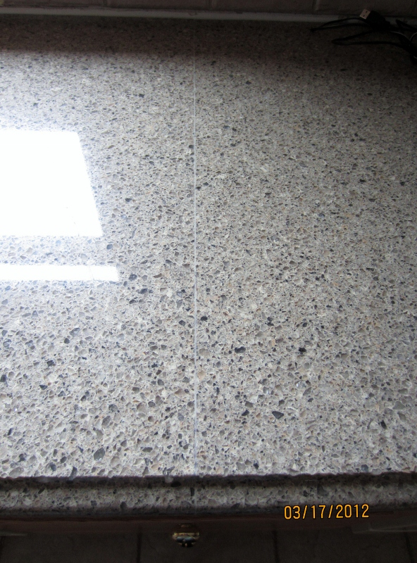 Bad quartz countertop seam granite counter top color html for Seamless quartz countertops