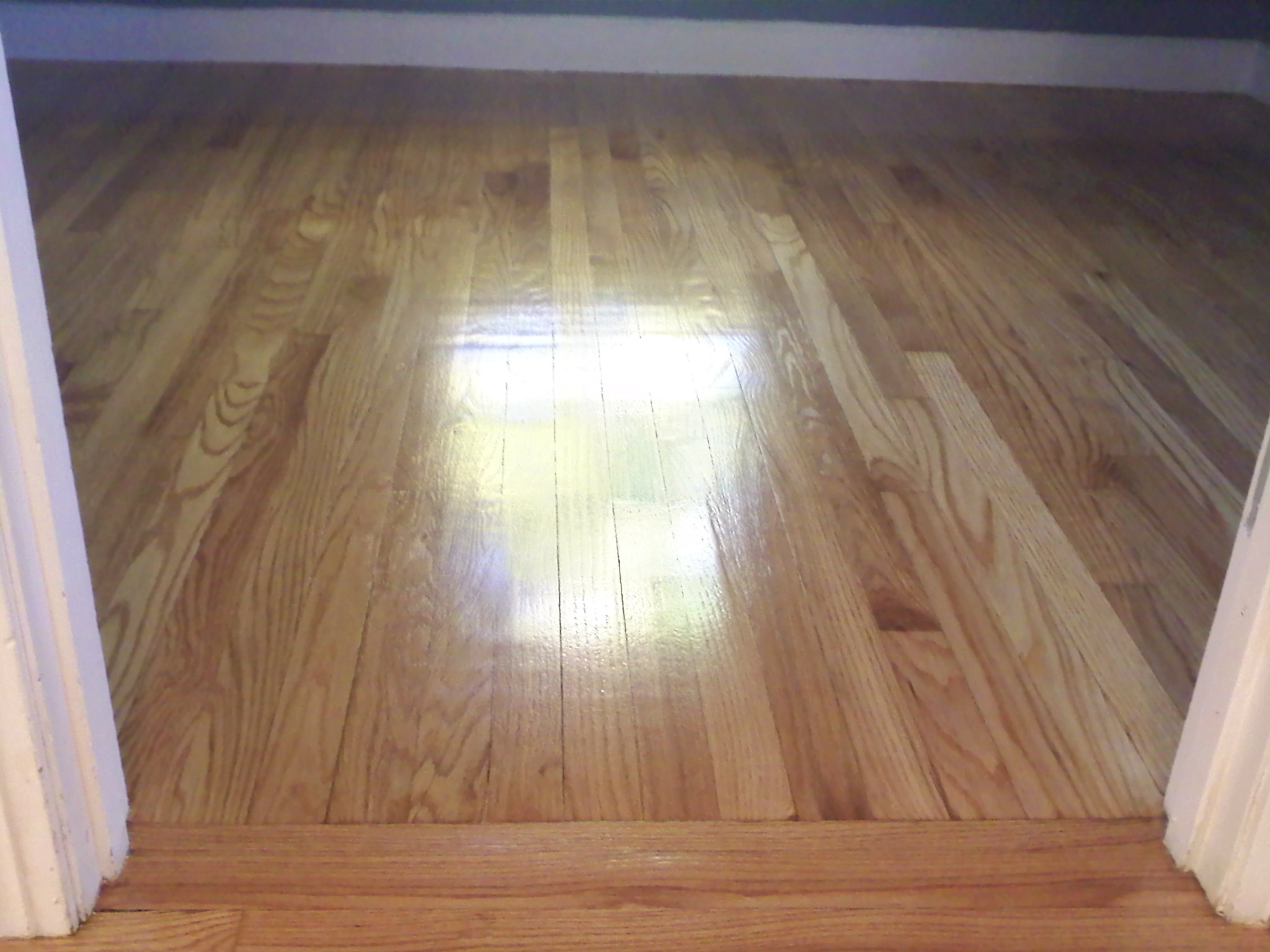 refinished wood floors wavy