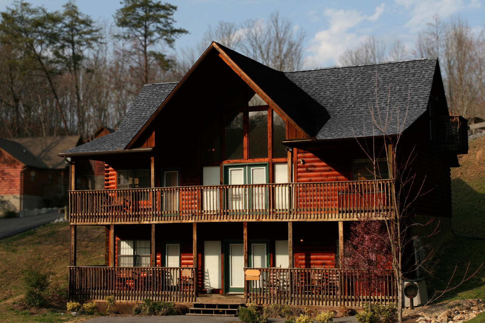Log home exterior colors joy studio design gallery for How to stain log cabin
