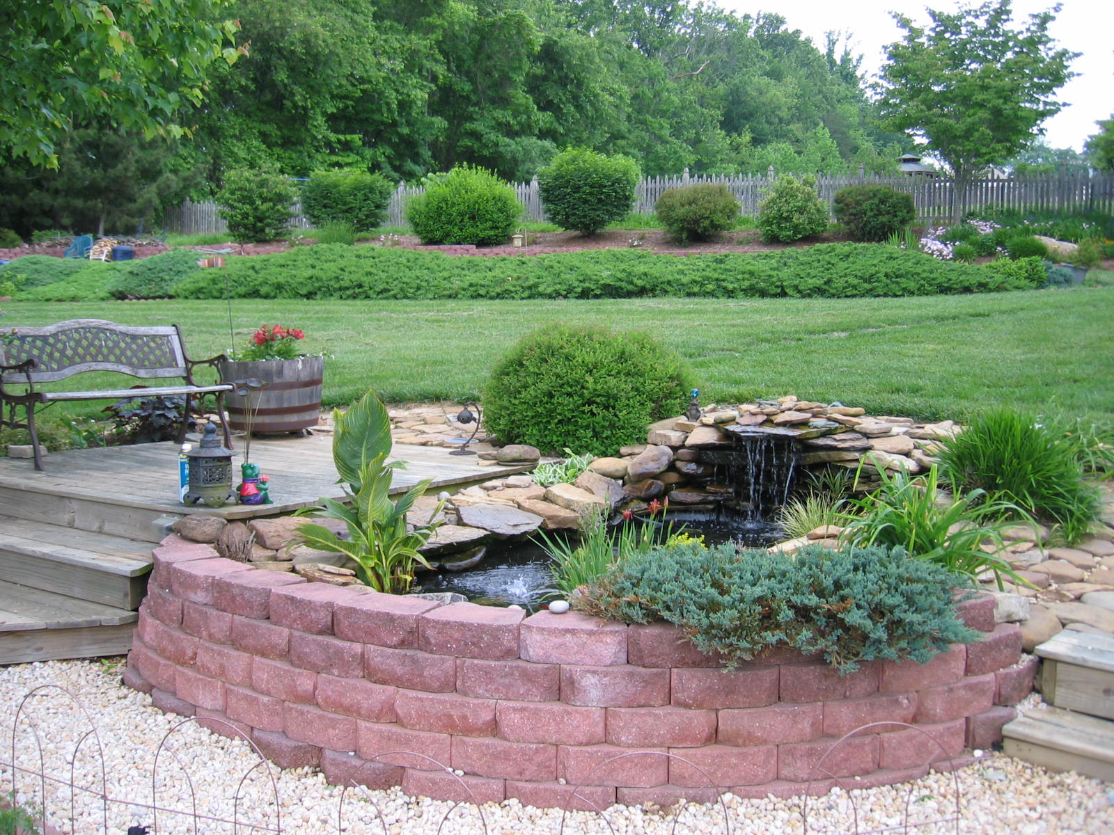 Backyard water feature window ac stove basement for Backyard ponds and water features