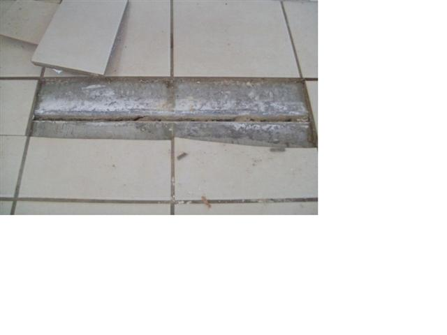 Do not fill or bridge concrete slab expansion joints. These joints ...