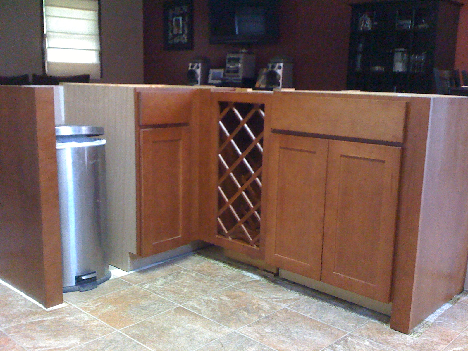 Installing 30 inch base wine rack next to base cabinets granite