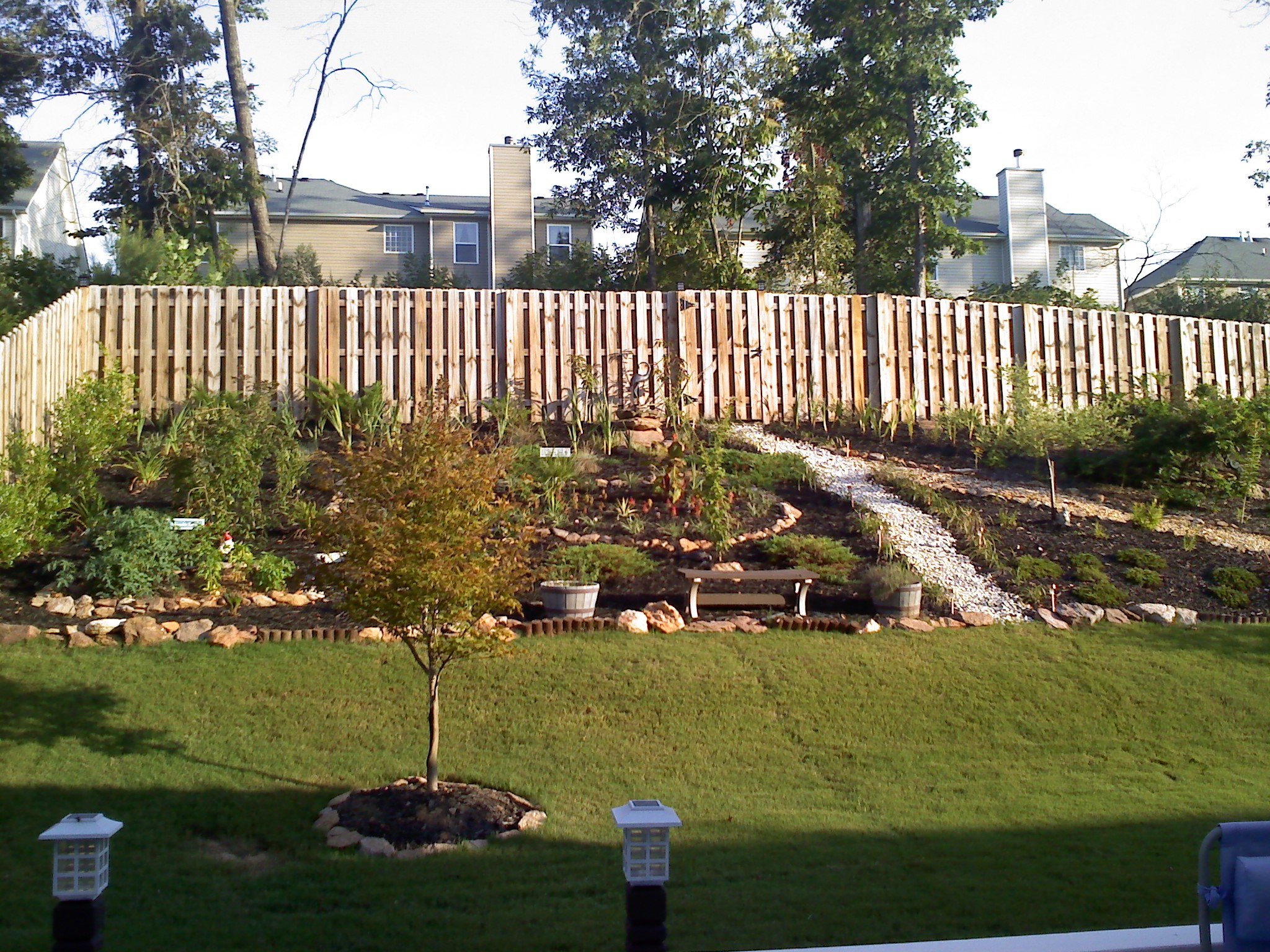 Tiered Backyard Pictures : Should we install a retaining wall in our backyard? (engineered