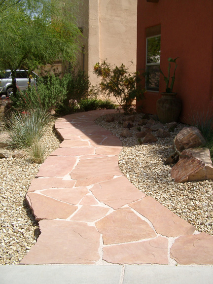 Replacing the front yard grass with rock landscaping for Las vegas stone yards