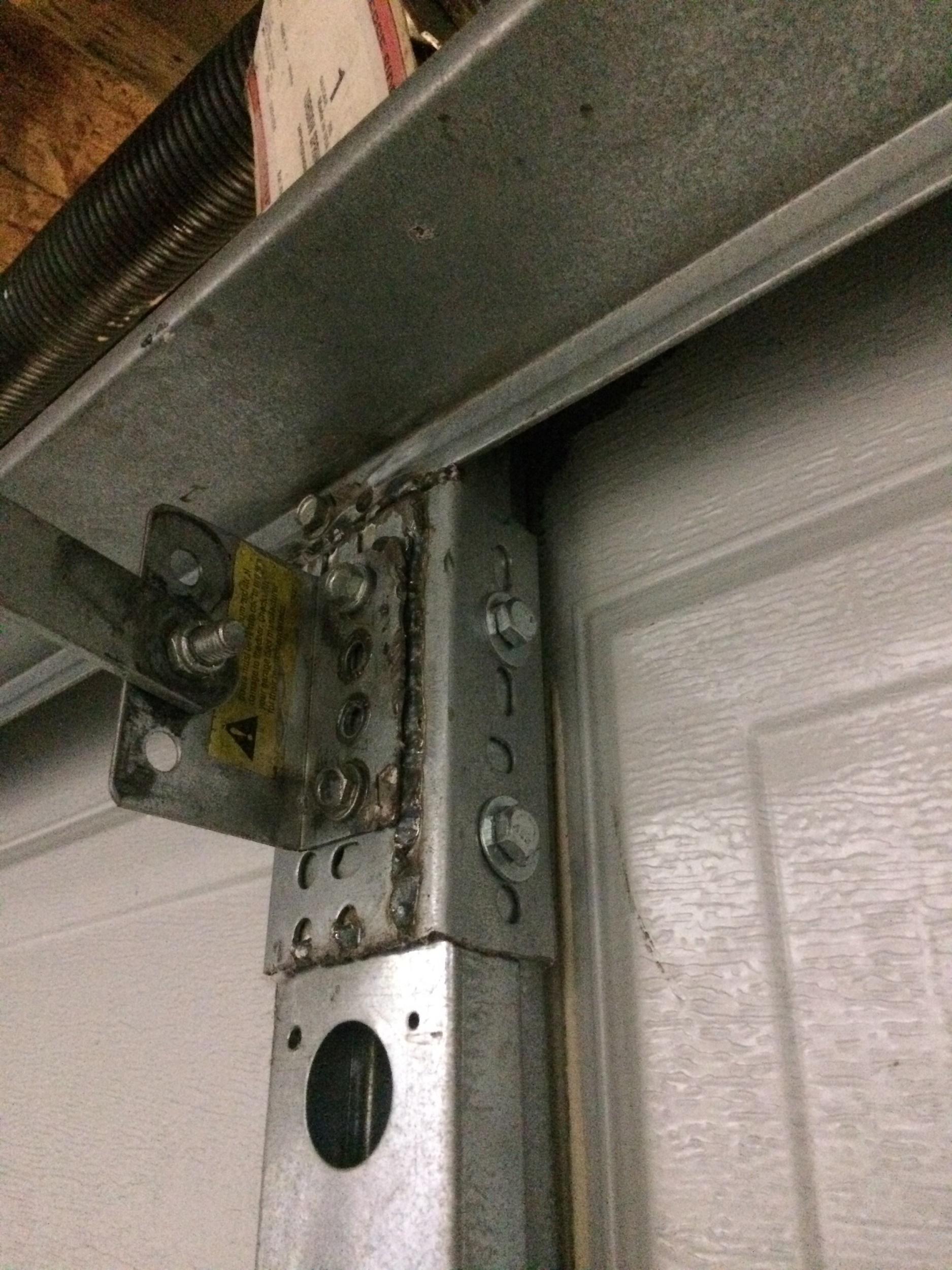 Garage Door Vertical Reinforcement Bracket Ideas Opener On Motor Diagram Broken Arm How Much Transfer To