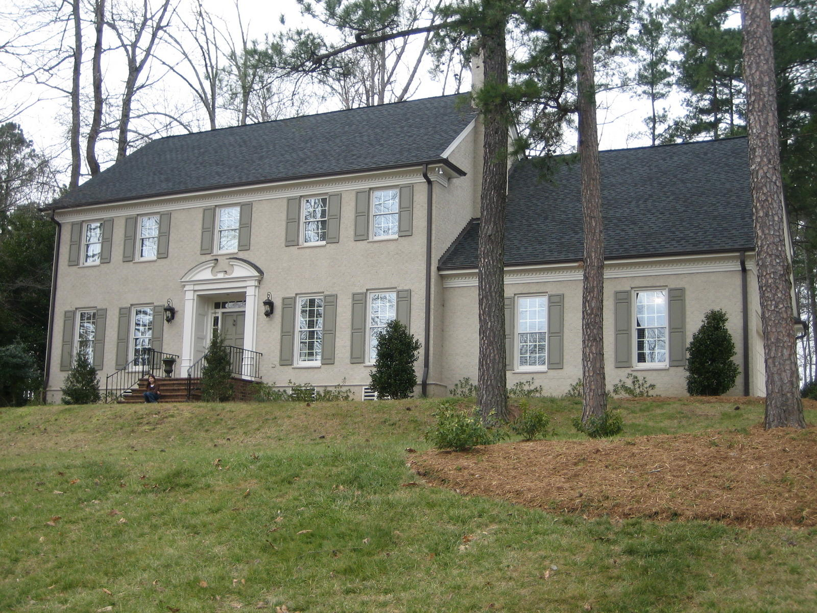 colonial revival federal style with stucco or painted brick siding