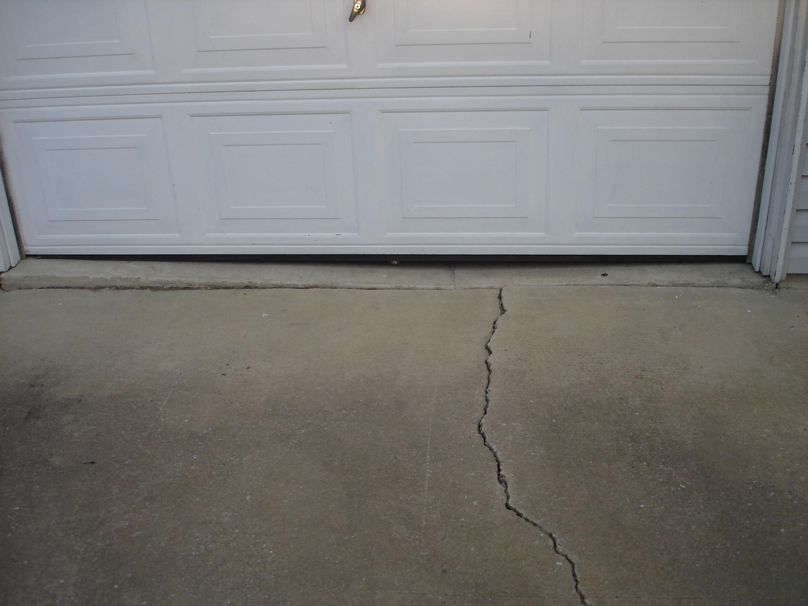 Cracked slab disclosure settlement price inspection for Garage slab thickness