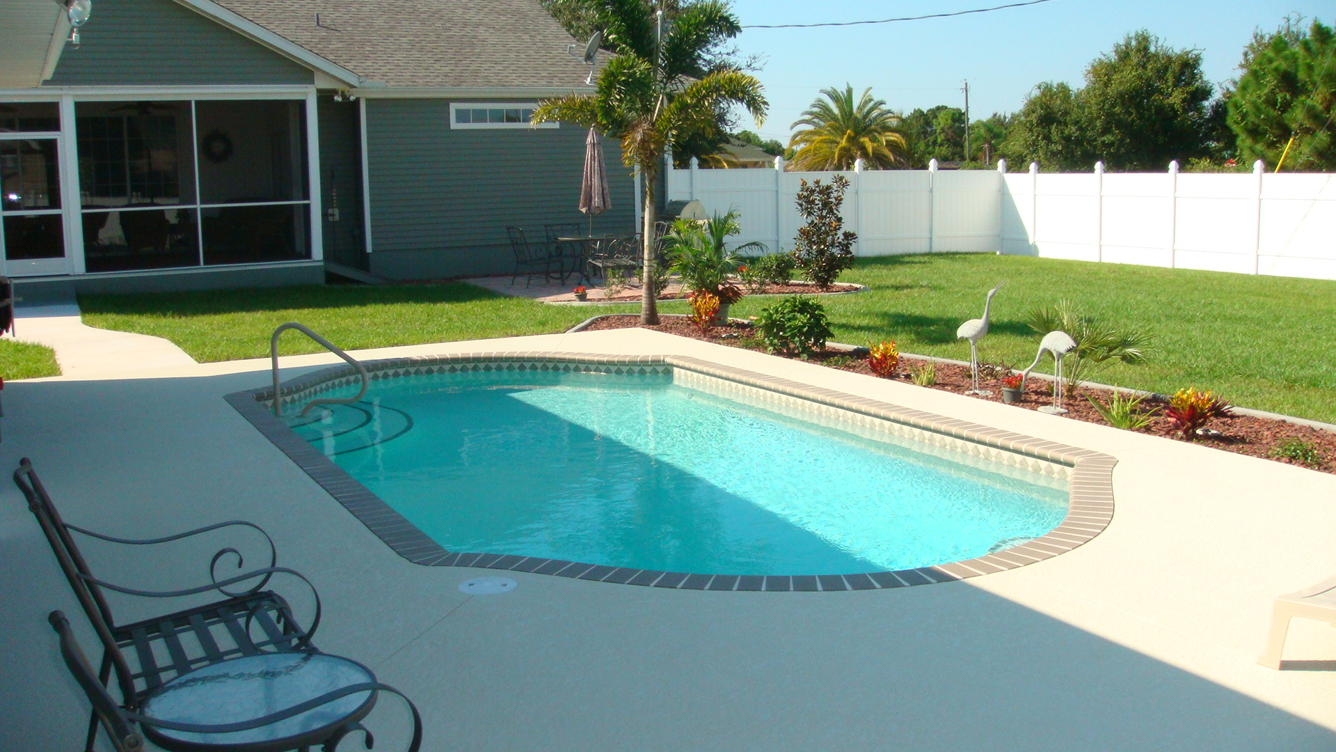 Stone around pool beauteous stone edge around pool design for Pool design concepts sarasota