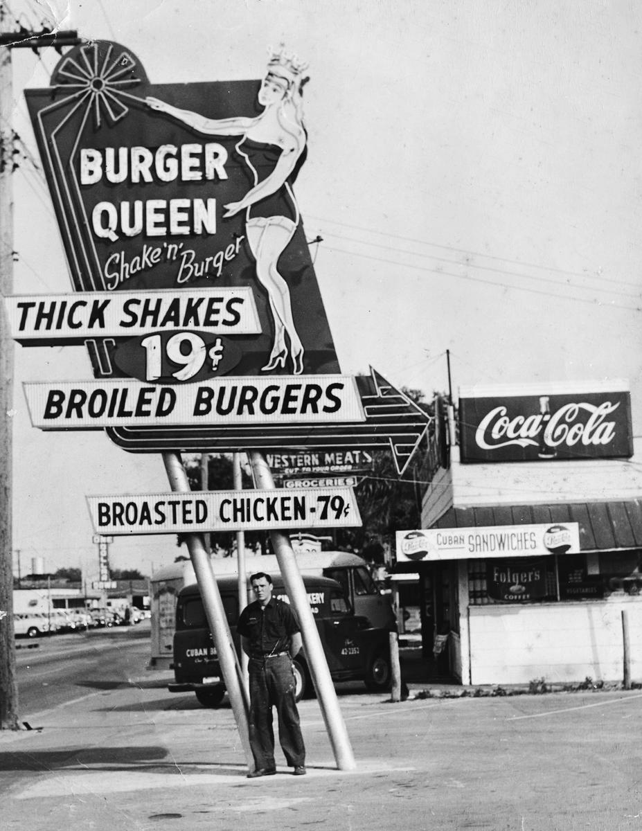 "1958-BurgerQueen FlaAve at Osborne in Seminole Heights. This sign features a 1950s beauty queen! This photo is among 200 in my new book ""Vintage Tampa Signs and Scenes"".  In thos photo, my Father John F Cinchett is standing next to his latest neon creation!"