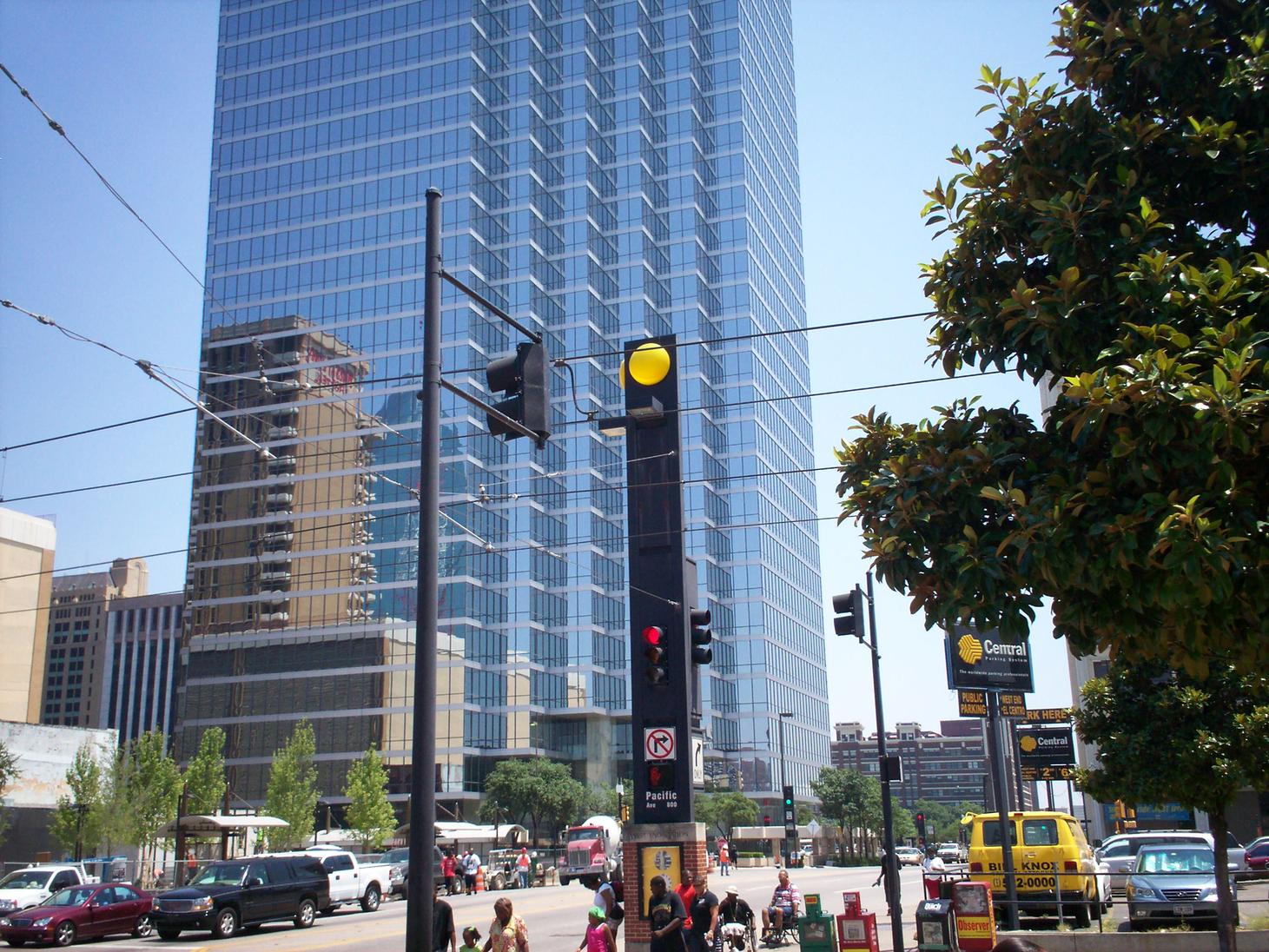 The base of tallest skyscraper in Dallas, and the 4th tallest in Texas.  Fountain Place is seen in the reflection.