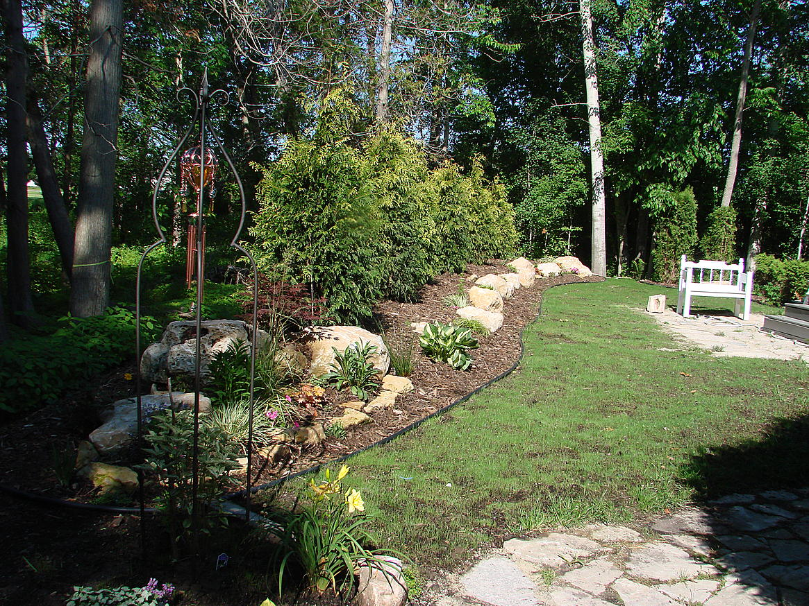 my backyard berm project and part of 7 tons of rock