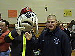 Oldest, Alex, standing next to my 2nd, Josh in the Puppy suit. Josh was the Fire Dog at the Fall Festival last year.