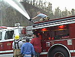 Our smalltown fire department with a bigtown heart. My son on top of the truck - playing in the water again!