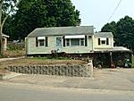 Our new (to us) home.  Aunt Bea and Uncle George left the house to my dad, and he sold it to us.  This is before we took it back to the studs! 2002