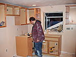 Hubby putting in kitchen cabinets.  I painted all the walls, 6 panel doors, and woodwork in the house.