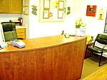 Reception and sign-in desk in the customer service waiting area of New Horizons Childcare learning center.