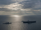 US ships take part in exercise with Malaysian ships.