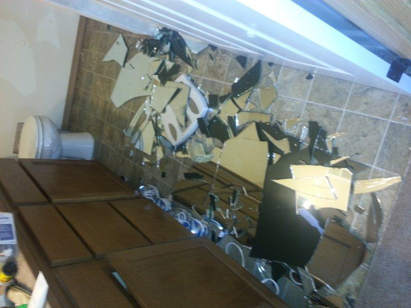 broken bathroom mirror bathroom mirror just fell the wall floor 12173