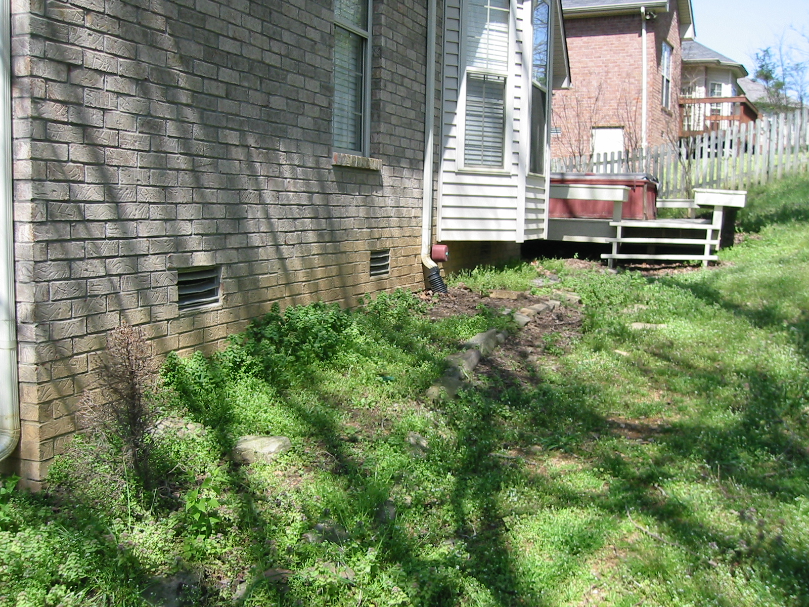 question about re-landscaping my backyard (building a retaining wall