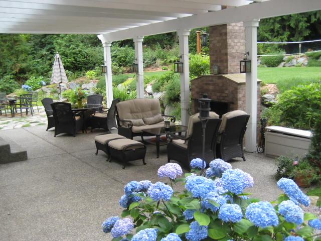 Which One To Choose Backyard Patio Concrete Vs Wood Deck Pvc